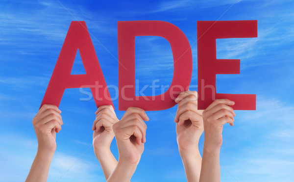 People Holding Straight German Word Ade Means Goodbye Blue Sky Stock photo © Nelosa