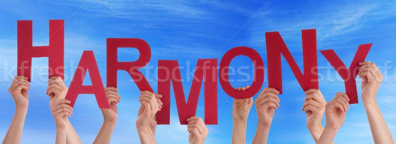 Many People Hands Holding Red Word Harmony Blue Sky Stock photo © Nelosa