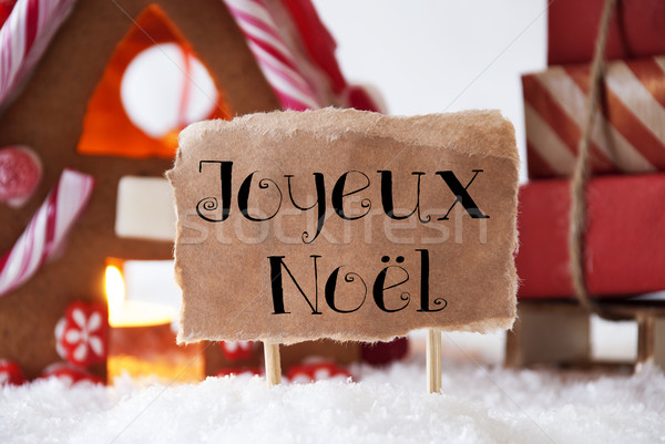 Gingerbread House With Sled, Joyeux Noel Means Merry Christmas Stock photo © Nelosa