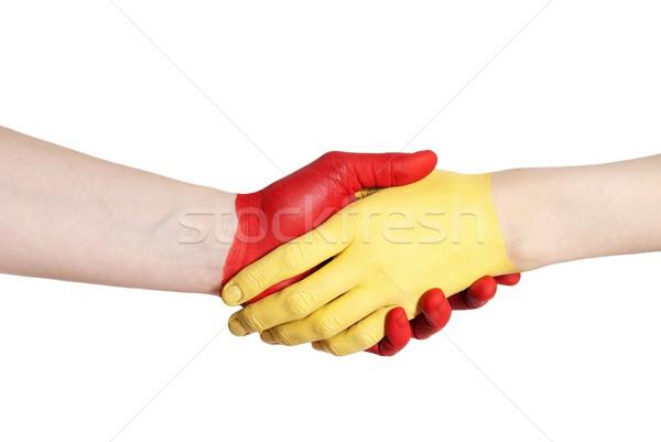 Jaune rouge handshake peint main isolé Photo stock © Nelosa