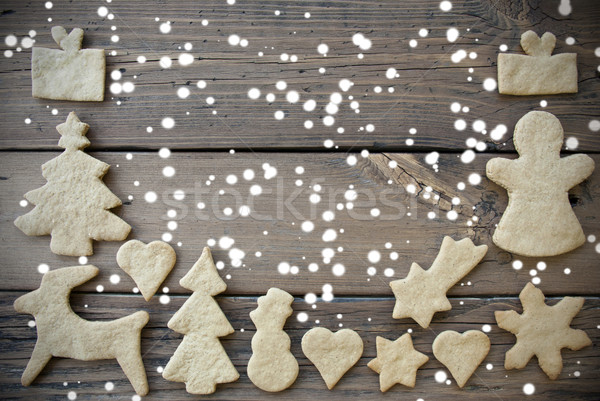 Ginger Bread Framing Wooden Background with Snow Stock photo © Nelosa
