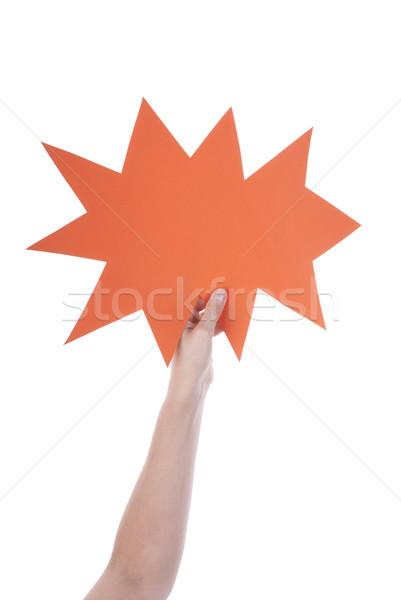 Narancs üres szöveglufi kéz tart szövegbuborék Stock fotó © Nelosa