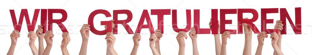 People Straight German Word Wir Gratulieren Means Congratulation Stock photo © Nelosa