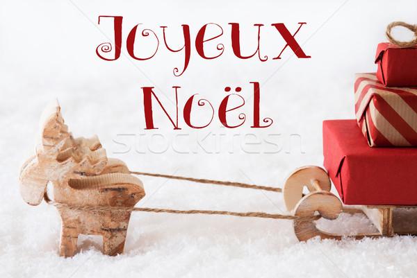Reindeer With Sled On Snow, Joyeux Noel Means Merry Christmas Stock photo © Nelosa