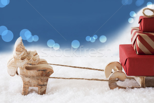 Reindeer With Sled, Blue Bokeh Background, Copy Space Stock photo © Nelosa
