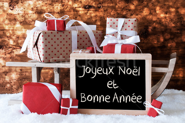 Sleigh With Gifts, Snow, Bokeh, Bonne Annee Means New Year Stock photo © Nelosa