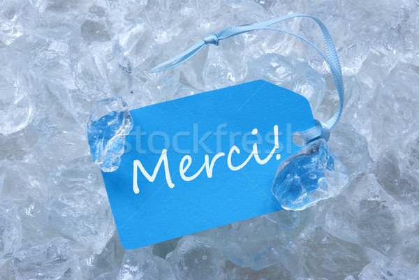 Blue Label On Ice With Merci Means Thank You Stock photo © Nelosa