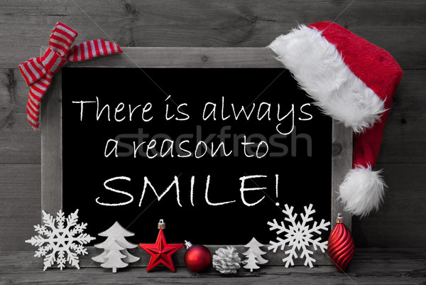 Blackboard Santa Hat Christmas Decoration Quote Reason Smile Stock photo © Nelosa