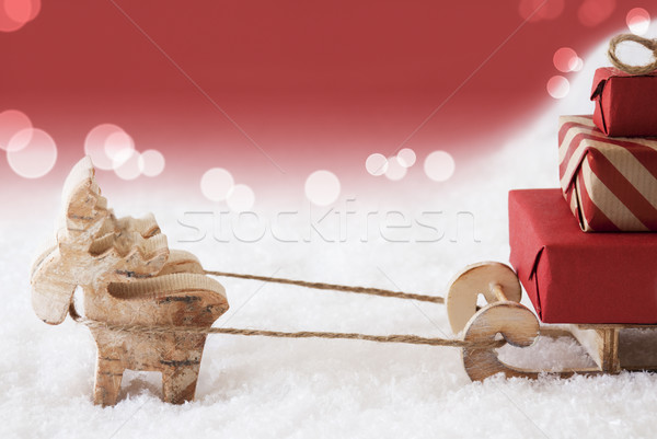 Reindeer With Sled, Red Bokeh Background, Copy Space Stock photo © Nelosa