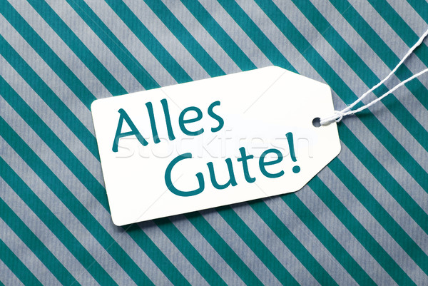 Label On Turquoise Wrapping Paper, Alles Gute Means Best Wishes Stock photo © Nelosa