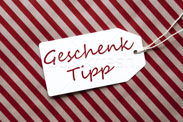 Label On Red Wrapping Paper, Geschenk Tipp Means Gift Tip Stock photo © Nelosa
