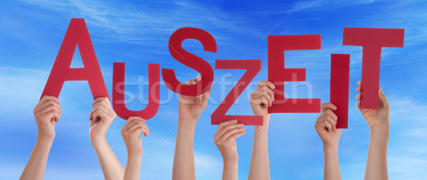 People Holding German Word Auszeit Means Downtime Blue Sky Stock photo © Nelosa