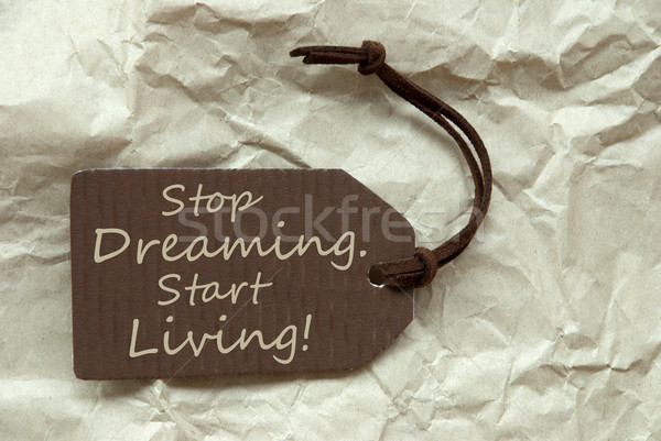 Brown Label With Quote Stop Dreaming Start Living Paper Backgrou Stock photo © Nelosa