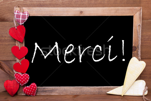 One Chalkbord, Red And Yellow Hearts, Merci Means Thank You Stock photo © Nelosa