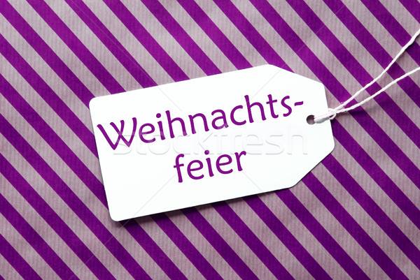 Label On Purple Wrapping Paper, Weihnachtsfeier Means Christmas Party Stock photo © Nelosa