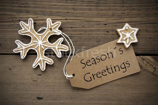 Season's Greetings on a Banner with Ginger Bread Cookies Stock photo © Nelosa