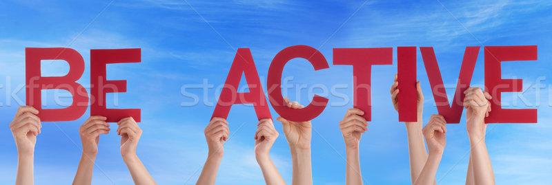 Kezek tart piros egyenes szó aktív Stock fotó © Nelosa