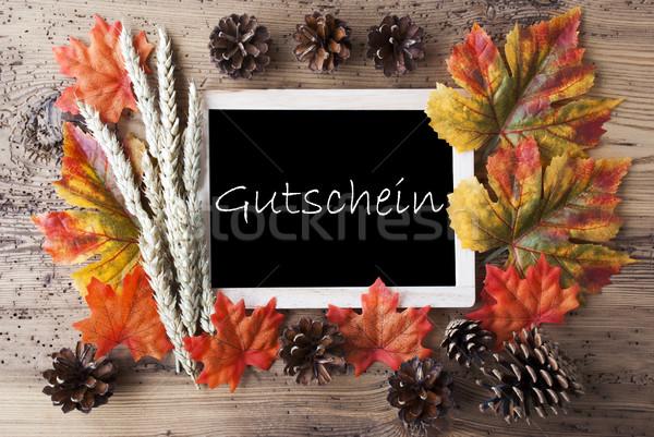 Chalkboard With Autumn Decoration, Gutschein Means Voucher Stock photo © Nelosa
