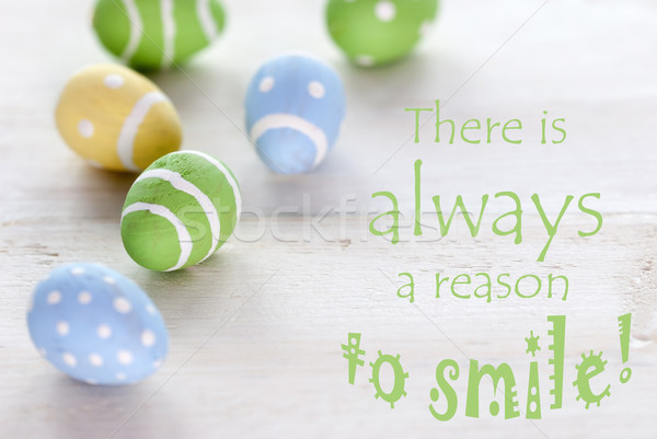 Blue Green And Yellow Easter Eggs With Life Quote There Is Always A Reason To Smile Stock photo © Nelosa