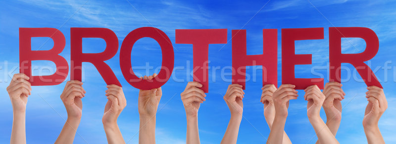 Many People Hands Holding Red Straight Word Brother Blue Sky Stock photo © Nelosa