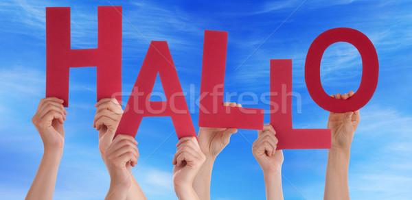 People Holding German Word Hallo Means Hello Blue Sky Stock photo © Nelosa