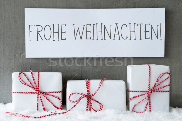 White Gift On Snow, Frohe Weihnachten Means Merry Christmas Stock photo © Nelosa