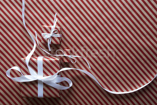 Two Gifts With White Ribbon On Red Wrapping Paper Stock photo © Nelosa