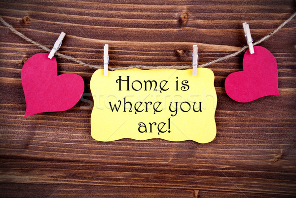 Yellow Lable Saying Home Is Where You Are Stock photo © Nelosa