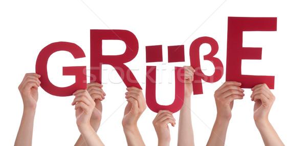 People Holding German Word Gruesse Means Regards Stock photo © Nelosa