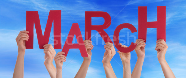Many People Hands Holding Red Word March Blue Sky Stock photo © Nelosa