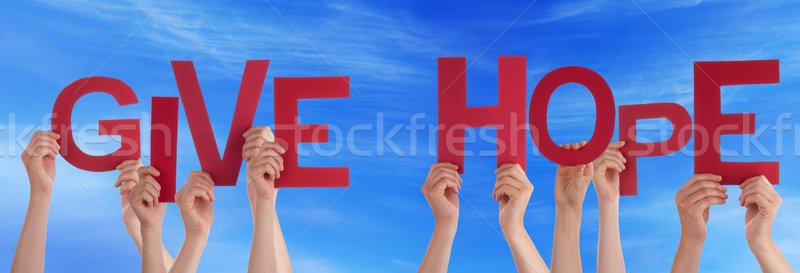 Ludzi ręce czerwony słowo dać Zdjęcia stock © Nelosa