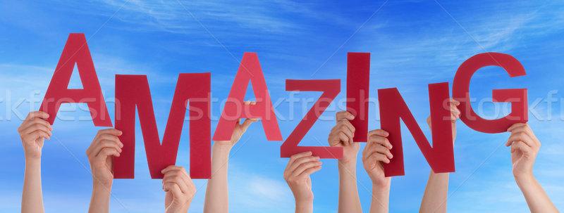 Wiele ludzi ręce utrzymać czerwony słowo Zdjęcia stock © Nelosa