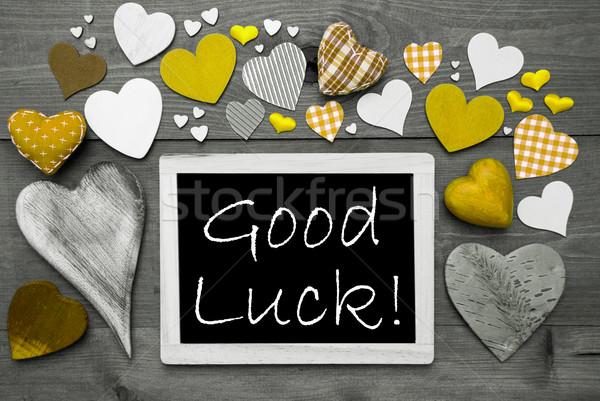Feketefehér sok citromsárga szívek jó szerencse Stock fotó © Nelosa