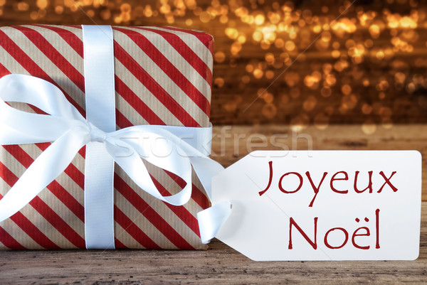 Atmospheric Gift With Label, Joyeux Noel Means Merry Christmas Stock photo © Nelosa