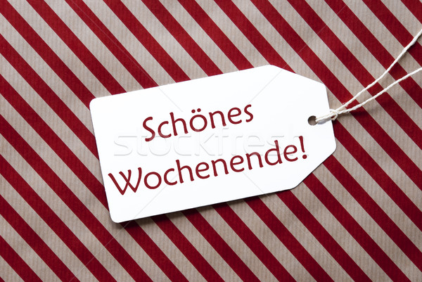 Label On Red Wrapping Paper, Schoenes Wochenende Means Happy Weekend Stock photo © Nelosa