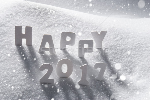 Text Happy 2017 With White Letters In Snow, Snowflakes stock photo ...