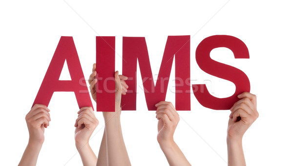 Stock photo: Many People Hands Holding Red Straight Word Aims