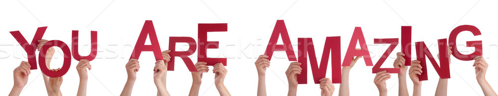 People Hands Holding Red Word You Are Amazing Stock photo © Nelosa