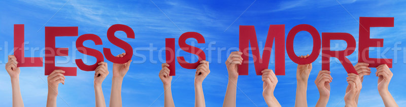 People Hands Hold Red Word Less Is More Blue Sky Stock photo © Nelosa