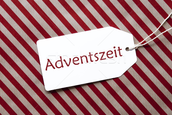 Label On Red Wrapping Paper, Adventszeit Means Advent Season Stock photo © Nelosa