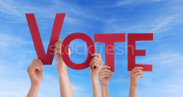 People Holding Vote in the Sky Stock photo © Nelosa