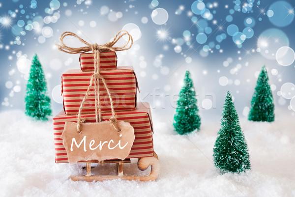 Christmas Sleigh On Blue Background, Merci Means Thank You Stock photo © Nelosa