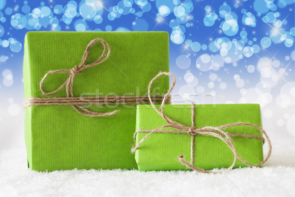 Two Green Gifts On Snow, Blue Bokeh Effect Stock photo © Nelosa