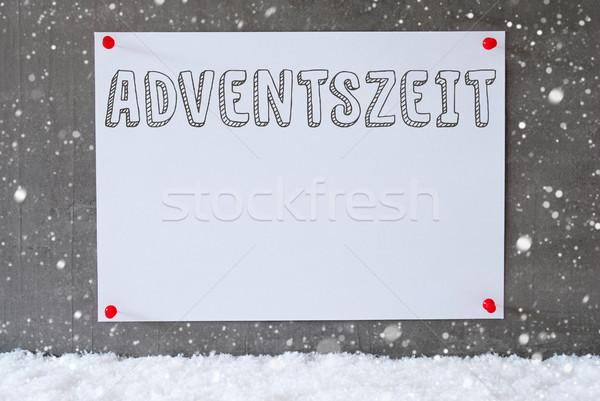 Label On Cement Wall, Snowflakes, Adventszeit Means Advent Season Stock photo © Nelosa