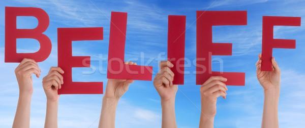 Mãos vermelho crença muitos céu Foto stock © Nelosa