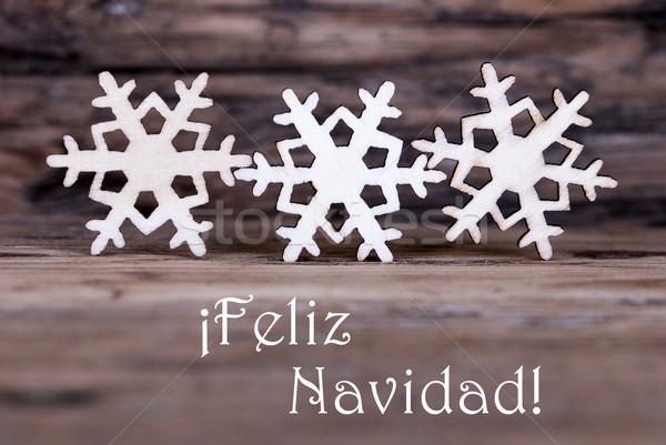Three Snowflakes with Feliz Navidad Stock photo © Nelosa