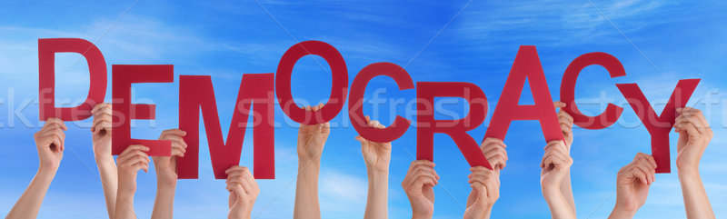 Many People Hands Holding Red Word Democracy Blue Sky Stock photo © Nelosa
