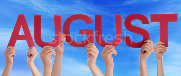 Hands Holding Red Straight Word August Blue Sky Stock photo © Nelosa