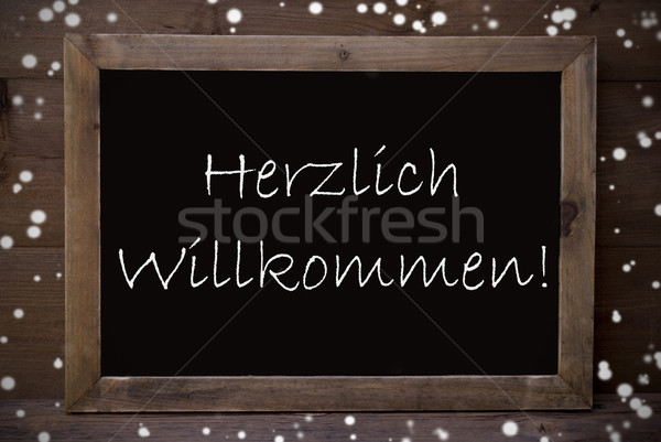 Chalkboard With Herzlich Willkommen Means Welcome, Snowflakes Stock photo © Nelosa