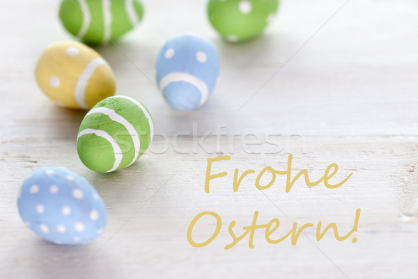 Blue Green And Yellow Easter Eggs With German Text Frohe Ostern Means Happy Easter Stock photo © Nelosa